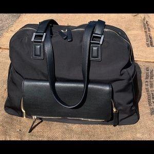 New Minkee Blue Carly tote black three in one bag.